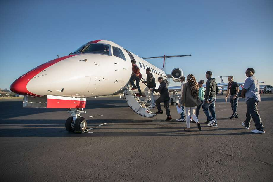 Richmond students board LA bound JetSuiteX's Embraer 135 on Tuesday, May 23, 2017 in Concord, Calif.  The trip takes about 1 hour. Photo: Paul Kuroda, Special To The Chronicle