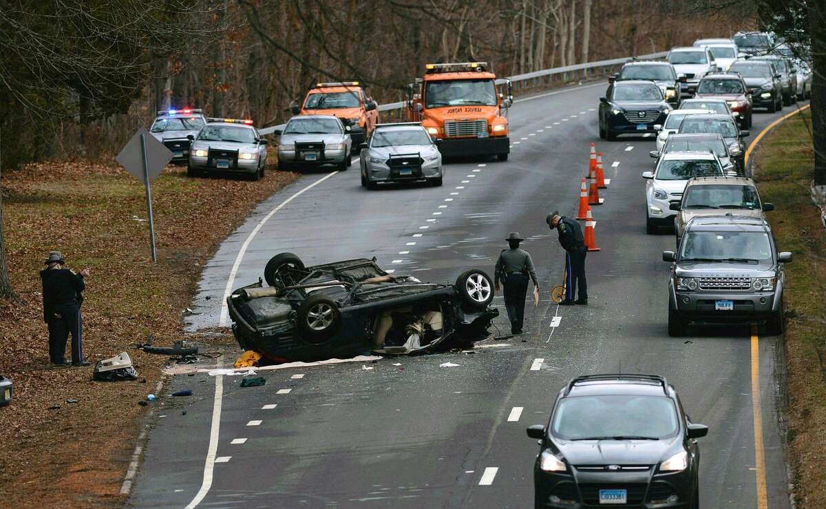 State Police investigate a serious rollover crash near Exit 41 on the Merritt Parkway in Norwalk, Conn. on Wednesday, Jan. 11, 2017.