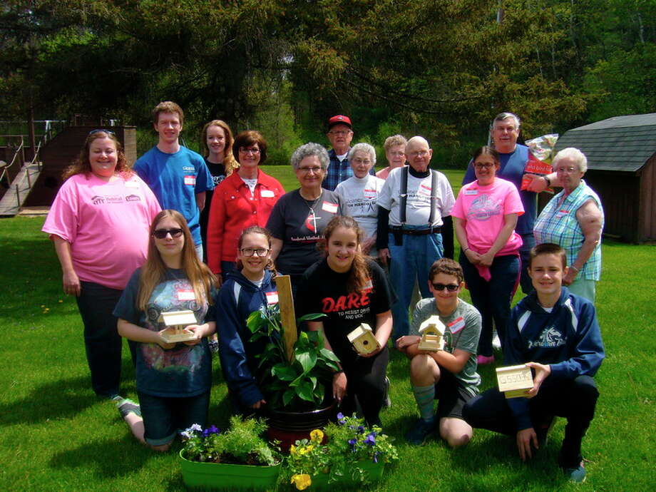 Members of Floyd Arbor 206 of the Gleaner Life Insurance Society build bird feeders and bird houses with Boy Scout Troop 776 and Girl Scout Troop 50350 on May 13 for Youth Action Day.