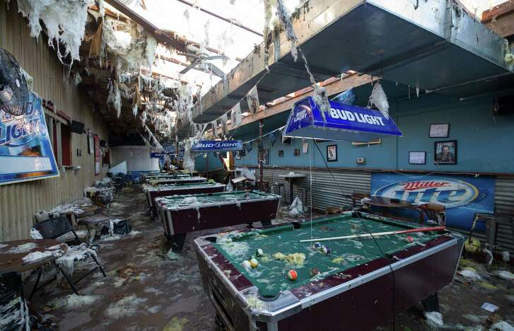 The storm's damage seen at Creekmore's Sports Bar Wednesday, May 24, 2017, in Sealy, Texas.