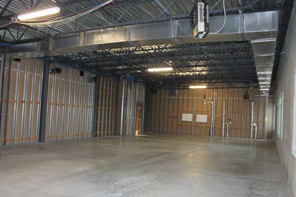 This space on the second floor at Father McGivney Catholic High School is planned to be divided into two classrooms, a band and choir room and private meeting space.
