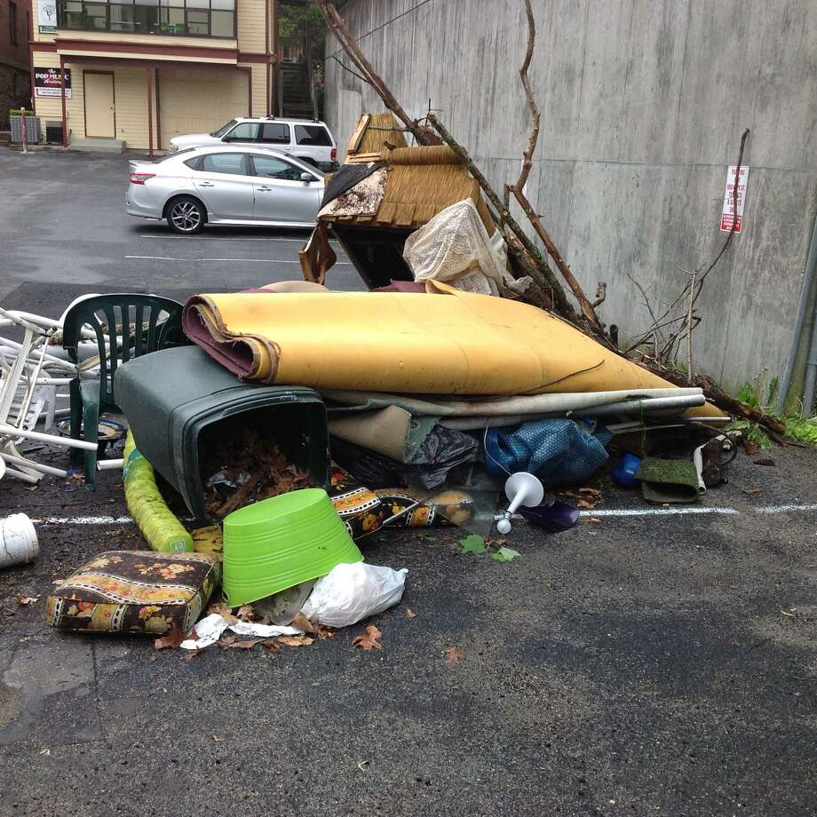 Property owner George Terenzio said someone pulled up their dump truck and left this mess on his property on Hope Street Sunday night. Photo: George Terenzio / Contributed