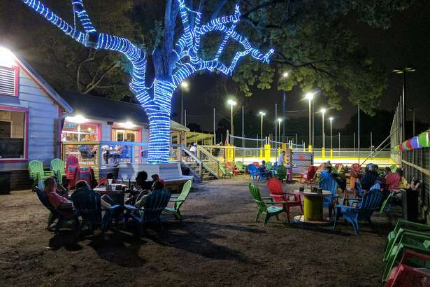 A new outdoor bar complete with three volleyball courts and giant game sets is set to officially open June 1 by the White Oak Music Hall. Photo courtesy of Matthew Richard