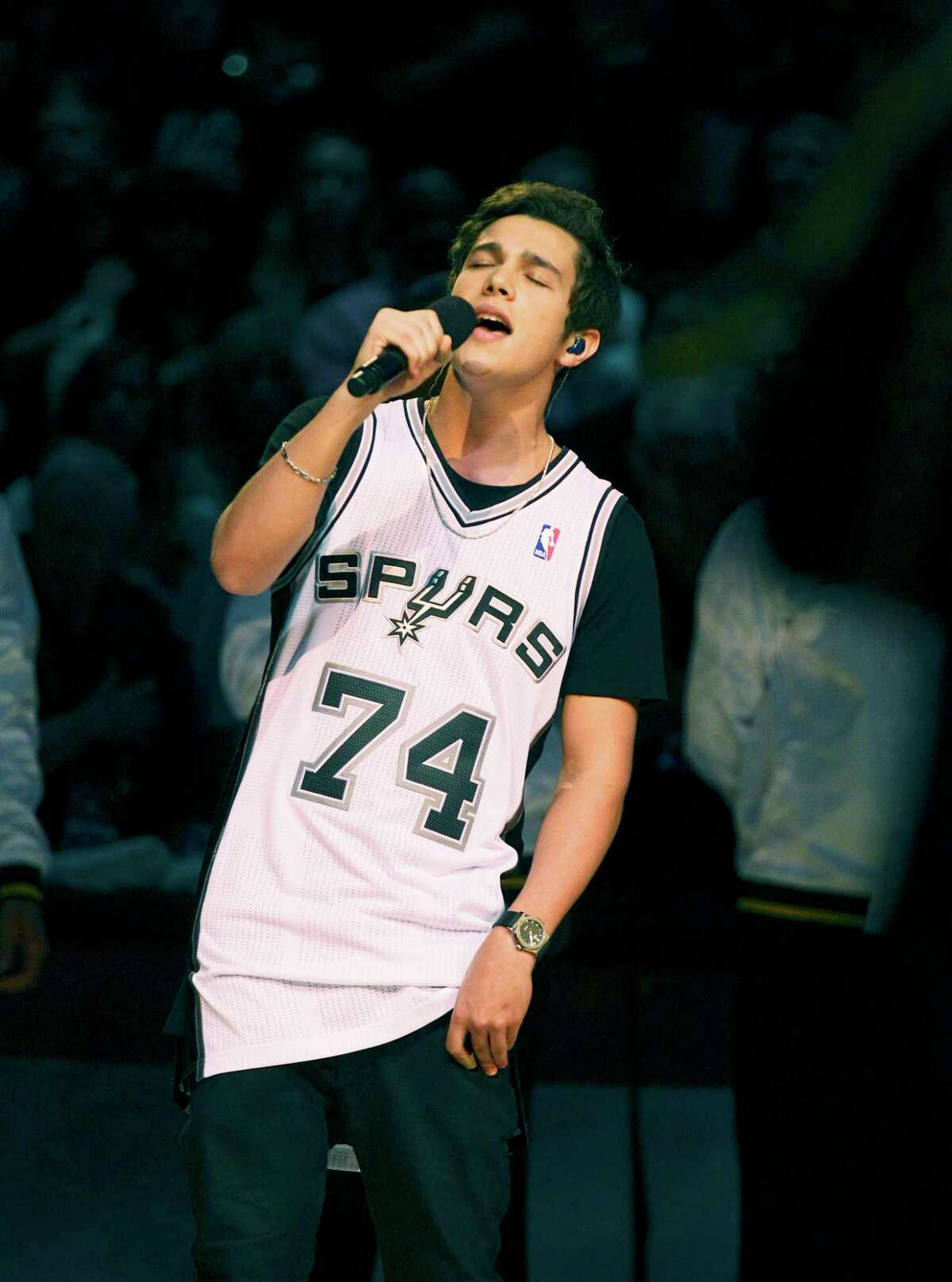 With an upcoming show at Paper Tiger, Austin Mahone, seen here singing the National Anthem before Game 1 of the 2014 NBA Finals, said Whataburger will be one of his first stops in San Antonio. Click ahead to view other places in S.A. where you might spot a celebrity.