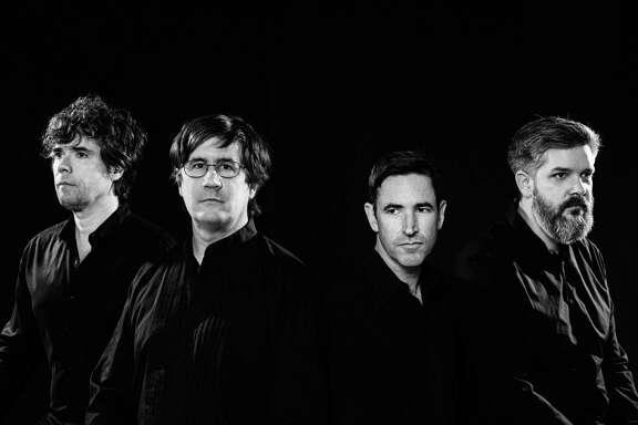 The Mountain Goats include, from left, Jon Wurster, John Darnielle, Peter Hughes and Matt Douglas.