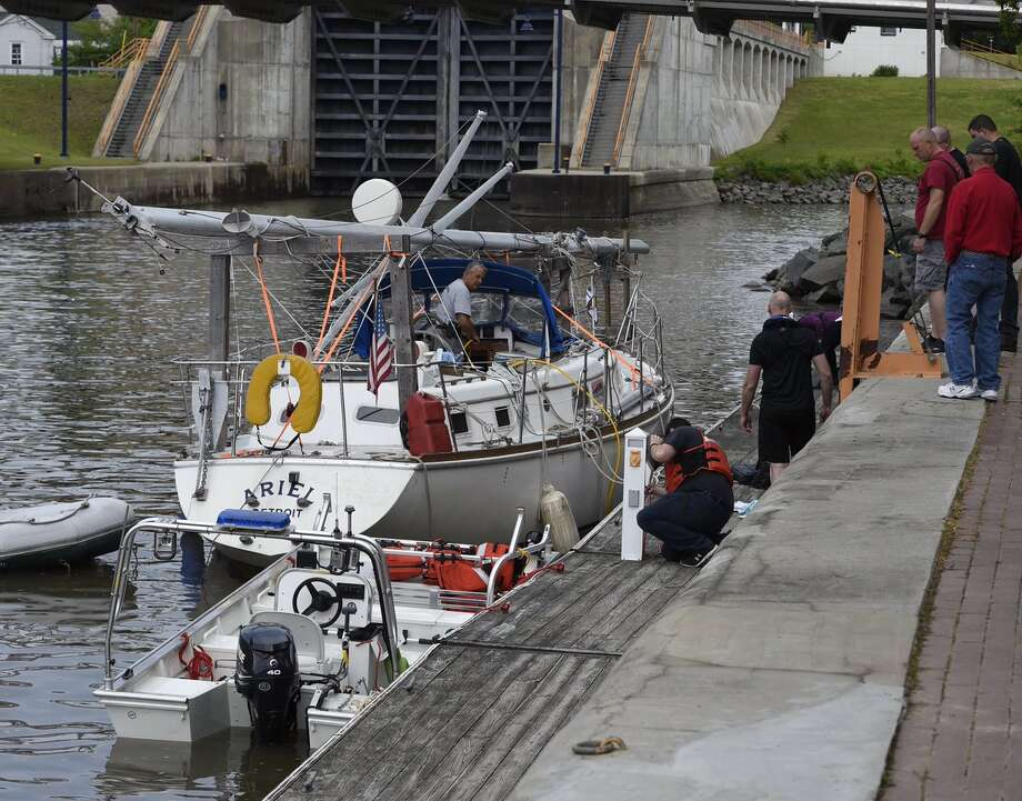 The owners of a boat are trying to figure out how to stop it from leaking. The sailboat, tied up near Lock 1 in Waterford, is taking on water. Police are helping the owners of the boat who were preparing to enter the Erie Canal for a sail to the Great Lakes. Photo: Skip Dickstein / Times Union