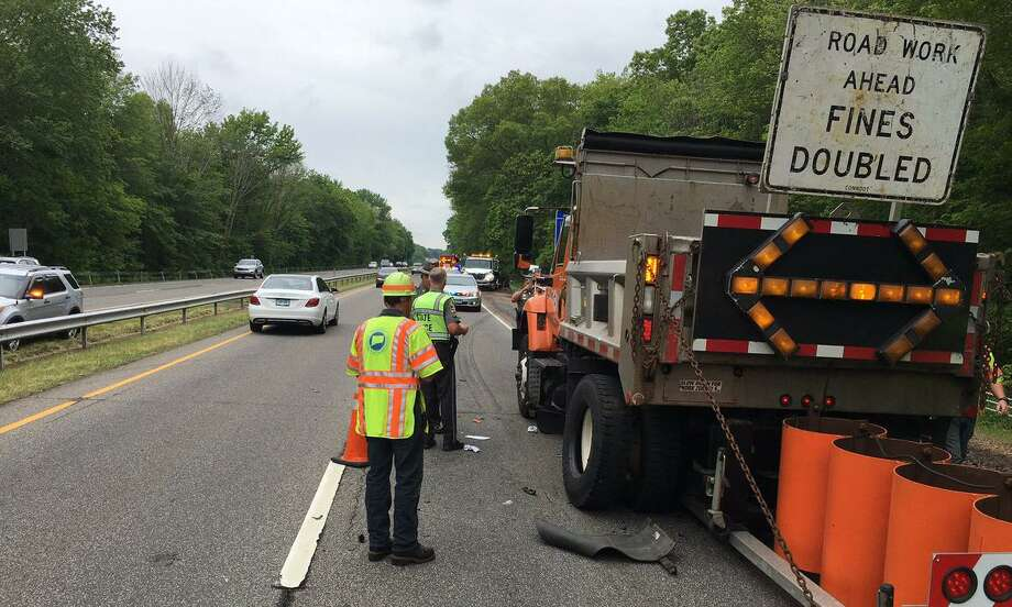 DOT workers and State Police respond after a DOT worker was struck on a road near New Haven, Conn., suffering non-life-threateing injuries. May 24, 2017. Photo: Contributed Photo / CSP / Contributed Photo / Connecticut Post