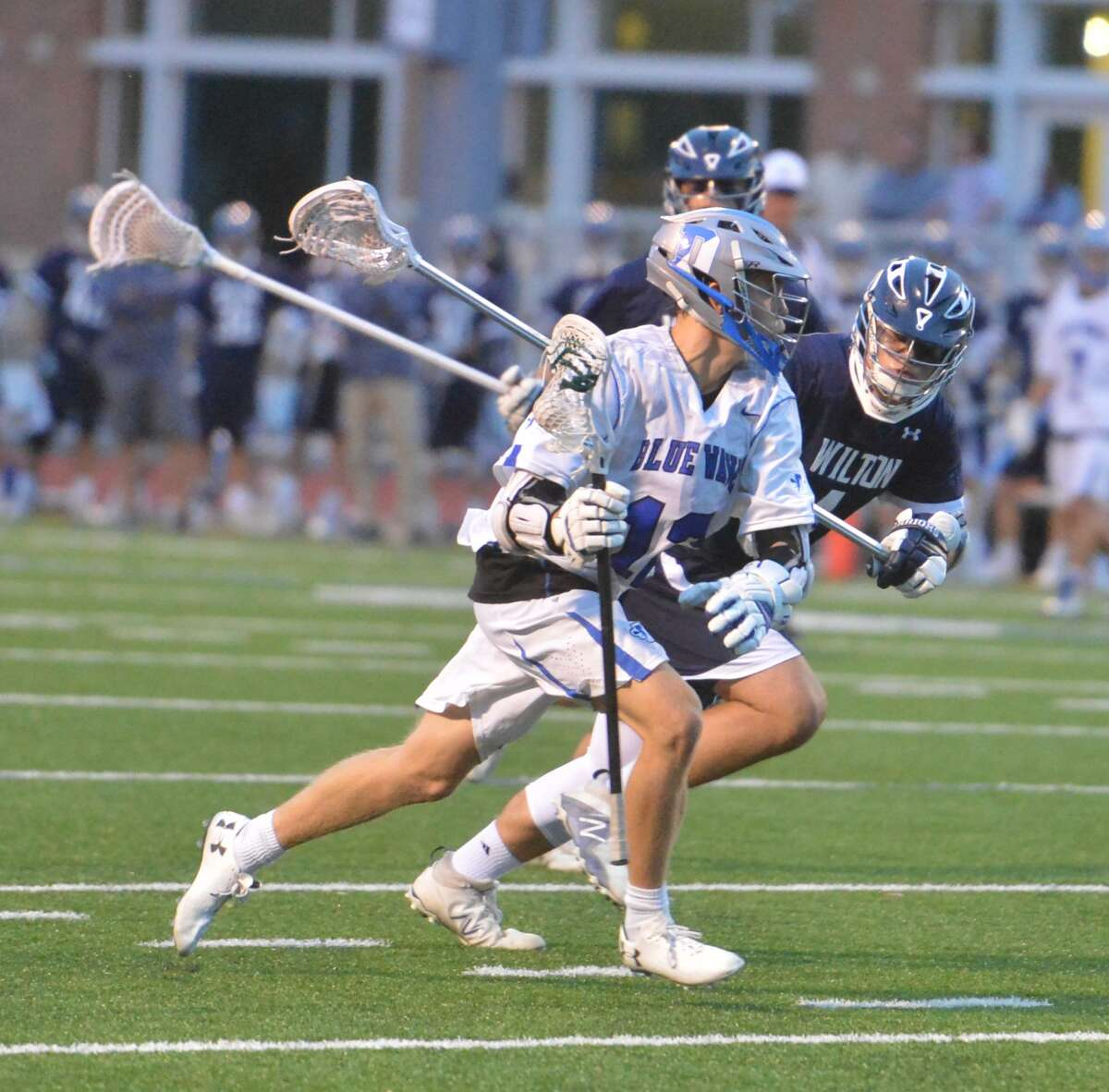 Darien's #12 Kevin Lindley moves in for a shot on goal vs. Wilton during FCIAC Boys Lacrosse semifinal game Tuesday May 23, 2017 in Norwalk Conn.