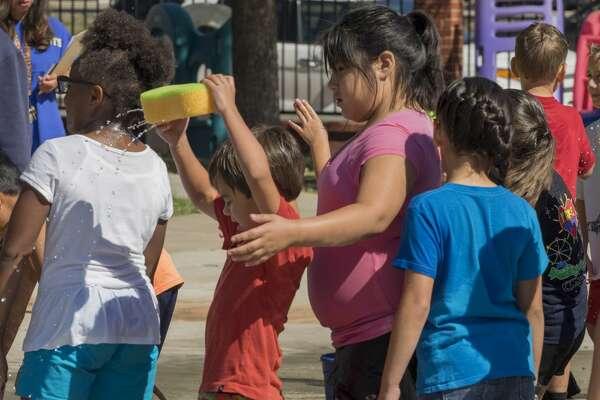St. Ann's students enjoy getting wet at the sponge relay 5/24/17 during field day fun. Tim Fischer/Reporter-Telegram