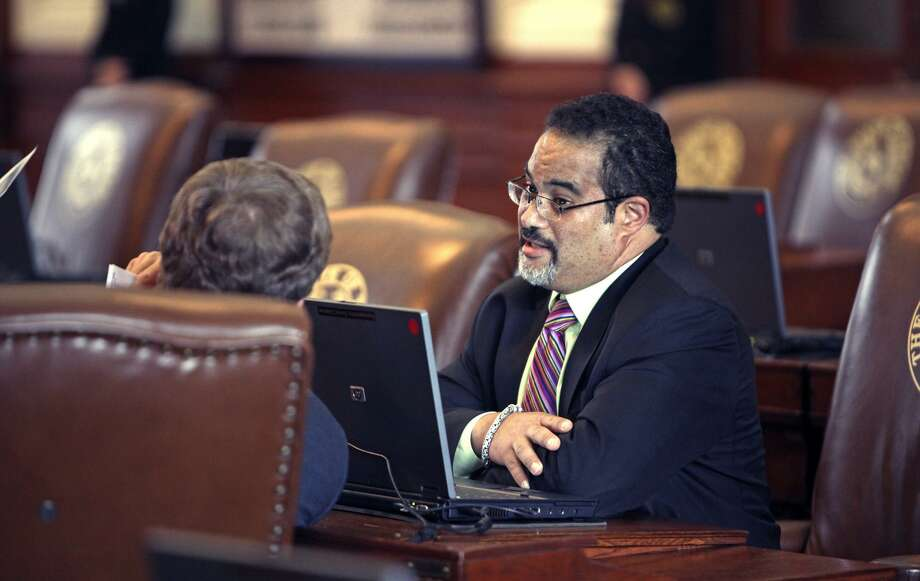 State Rep. Garnet Coleman, D-Houston, talks from his desk on the floor of the Texas House of Representatives in this file photo. Coleman said he would kill his bill rather than allow Senate amendments to it that would impose restrictions on bathroom use and would impose reduced automatic rollback levels for property taxes. Photo: TOM REEL /SAN ANTONIO EXPRESS-NEWS / treel@express-news.net