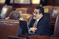 State Rep. Garnet Coleman, D-Houston, talks from his desk on the floor of the Texas House of Representatives in this file photo. Coleman said he would kill his bill rather than allow Senate amendments to it that would impose restrictions on bathroom use and would impose reduced automatic rollback levels for property taxes.