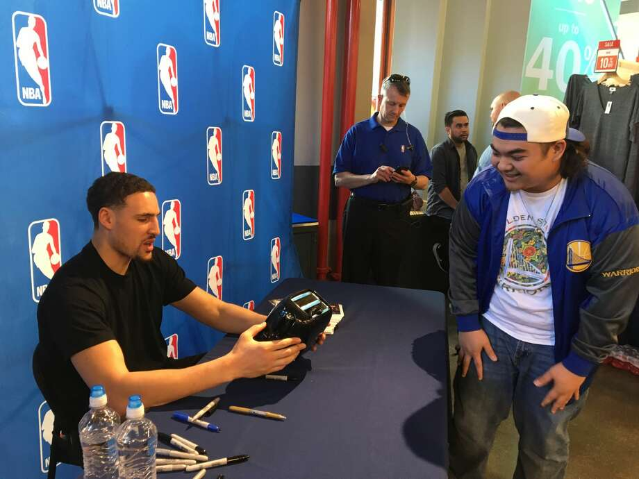 Ronnie Reyes gets his famous Warriors toaster signed by Klay Thompson. Photo: Ronnie Reyes/Courtesy