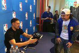 Ronnie Reyes gets his famous Warriors toaster signed by Klay Thompson.