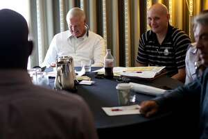 Golden State Warriors executives including (from left) executive board member Jerry West and assistant general manager of player personnel Travis Schlenk laugh as they interview a prospect during the NBA draft combine in Chicago on Thursday, June 7, 2012.