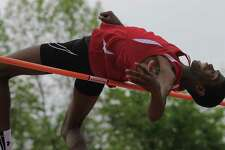 Greenwich Safir Scott attempts to set a new Connecticut State High Jump record by clearing 7-00.5 during the FCIAC boys track and field championship at Ridgefield High School on May 23, 2017. Scott won the event with a jump of 6-08.