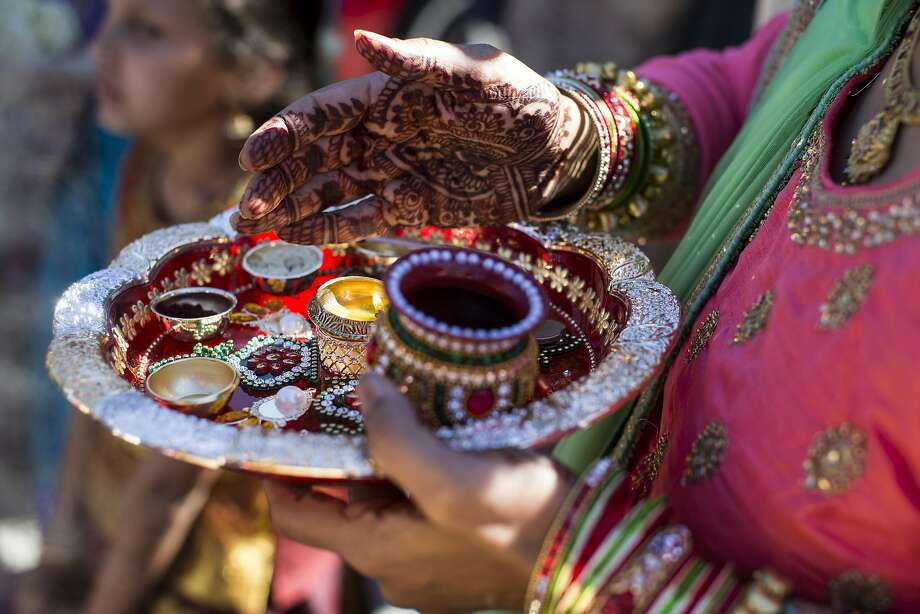A Hindu aarti plate is used for offerings and blessings at the ceremony. Photo: Laura Morton, Special To The Chronicle