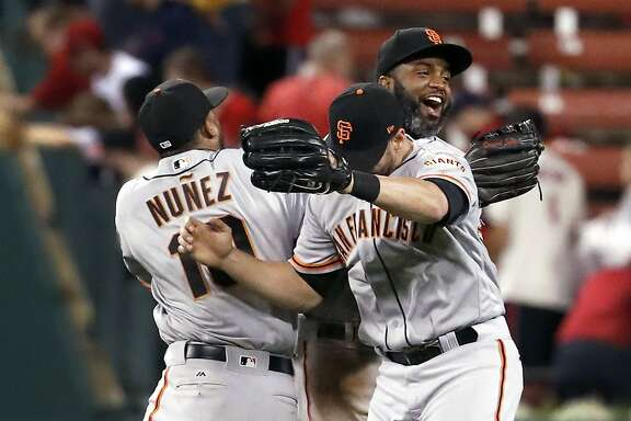 San Francisco Giants outfielders Eduardo Nunez, left, Justin Ruggiano, front right, and Denard Span celebrate following a baseball game against the St. Louis Cardinals Saturday, May 20, 2017, in St. Louis. The Giants won 3-1 in 13 innings. (AP Photo/Jeff Roberson)
