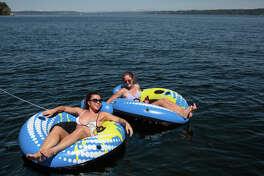Women relax at Madrona Beach on Lake Washington on Tuesday, May 23, 2017.