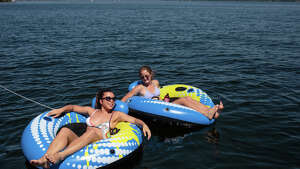 Women relax at Madrona Beach on Lake Washington on Tuesday, May 23, 2017.