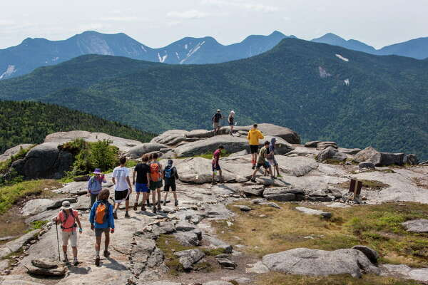 Hikers stand on the summit of Cascade Mountain on July 20, 2016. (Nancie Battaglia/Special to the Times Union)