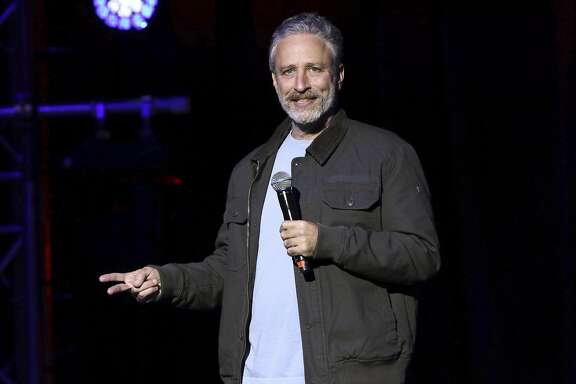 FILE - In this Tuesday, Nov. 10, 2015, file photo, comedian Jon Stewart performs at the 9th Annual Stand Up For Heroes event, in New York.  HBO is scrapping a web-delivered satirical project it was developing with Stewart.   (Photo by Greg Allen/Invision/AP, File)