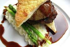 Beef Wellington with pastry and pâté, served with bordelaise sauce, potatoes mousseline and asparagus at Fig Tree Restaurant.