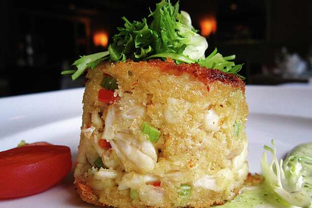 Gulf lump crab cake with Green Goddess sauce is still on the menu after a summer menu revamp at Fig Tree.