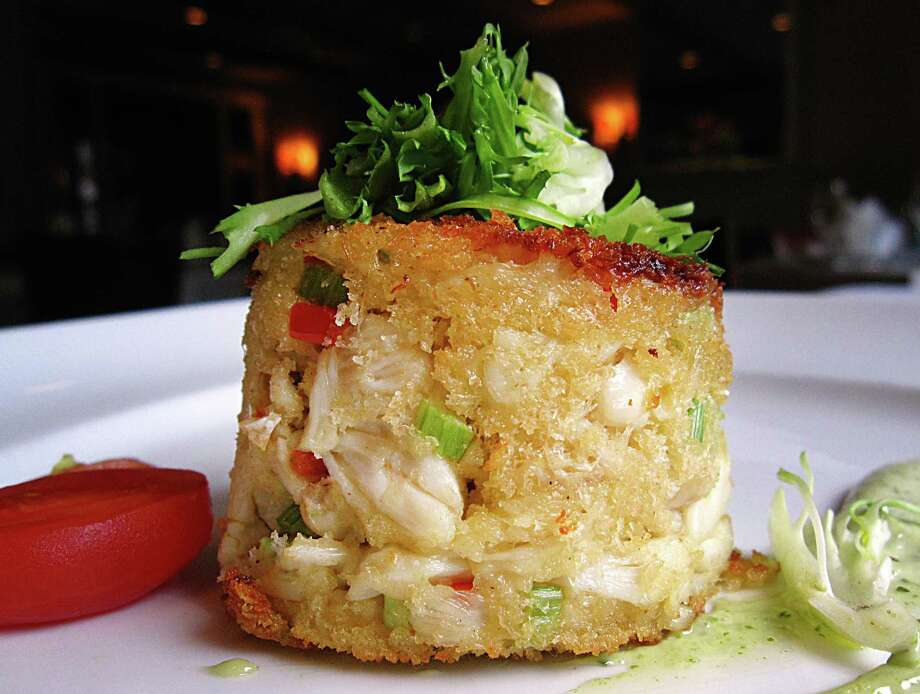 Gulf lump crab cake with Green Goddess sauce is still on the menu after a summer menu revamp at Fig Tree. Photo: Mike Sutter /San Antonio Express-News