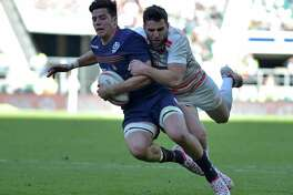 Scotland's Hugh Blake is tackled during the cup final match of the World Rugby Sevens Series this week. NBC Sports Group has acquired the exclusive U.S. media rights to the rugby World Cup through a seven-year partnership with World Rugby, both parties announced Monday.