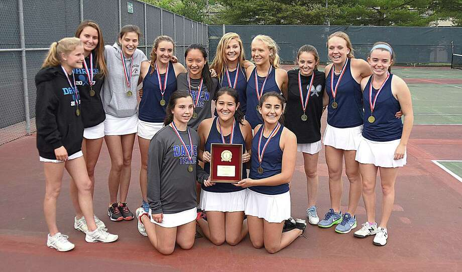 The Darien girls tennis team celebrates its second straight FCIAC championship by posing with the trophy after defeating Staples in the title match 4-3 on Tuesday at Wilton High School. Photo: John Nash / Hearst Connecticut Media / Norwalk Hour