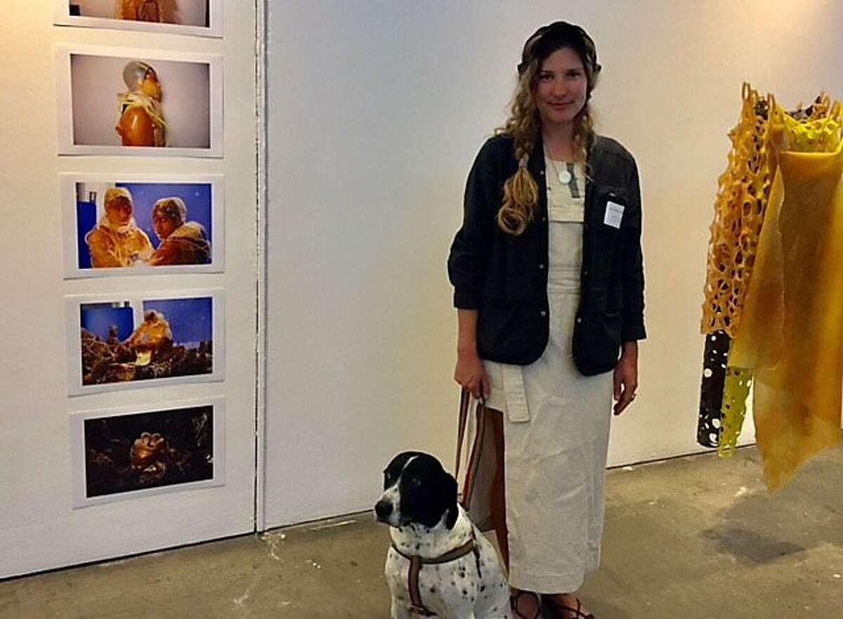 Ashley Eva Brock next to her art, at CCA gala