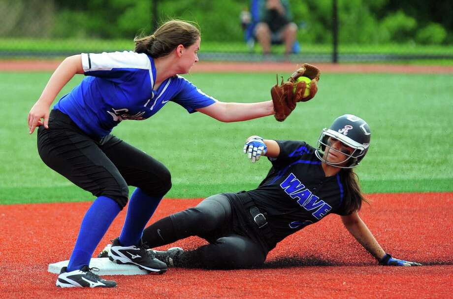 Darien's Kalani Caruso slides into second base as Fairfield Ludlowe's looks to tag her out during FCIAC softball semi-final action at Sacred Heart University in Fairfield, Conn., on Tuesday May 23, 2017. Caruso was called safe. Photo: Christian Abraham / Hearst Connecticut Media / Connecticut Post