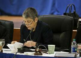 University of California President Janet Napolitano reads through papers during the public comment period of the Board of Regents meeting Thursday, May 18, 2017, in San Francisco. California's state auditor briefed the governing board Thursday on findings that UC administrators hid $175 million in a secret reserve fund even as the system raised tuition and sought more public funding. Howle says her office found murky budgeting practices in the office of UC President Janet Napolitano that failed to track expenditures and explain decision-making. (AP Photo/Eric Risberg)