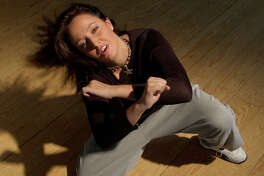 Dance teacher Tesia Truitt shows off a dance move on Friday, March 12, 2004. (Melissa Phillip/Chronicle)