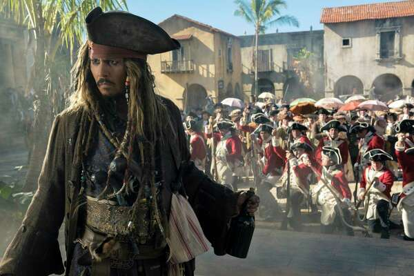 """In this image released by Disney, Johnny Depp portrays Jack Sparrow in a scene from """"Pirates of the Caribbean: Dead Men Tell No Tales."""" (Peter Mountain/Disney via AP) ORG XMIT: NYET715"""