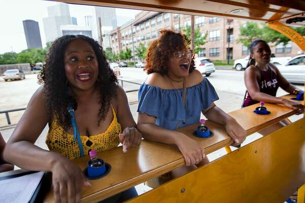 Erica Newman, Stephanie Holmes and Courtney Minick are surprised at the strength needed to start their Pedal Party on Saturday, May 20, 2017, in Midtown. People can rent the bikes for two-hour time slots for birthday parties and social gatherings. (Annie Mulligan / Freelance)