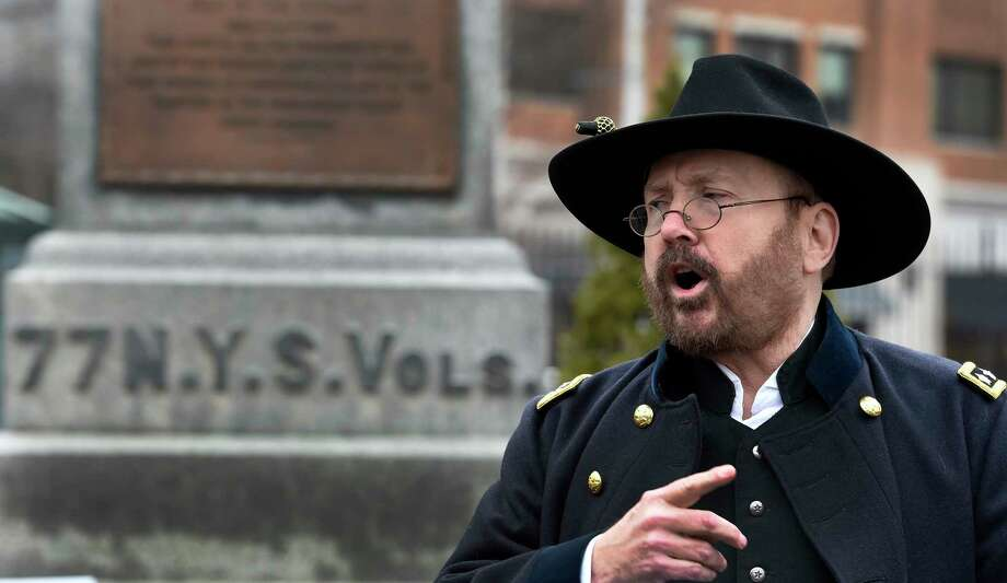 Steve Trimm of the Grant Cottage staff, dressed as Gen. U. S. Grant, gives a speech about the moments preceding the surrender of Gen. Lee to Gen. Grant to end the Civil War during a ceremony to commemorate to the 150th anniversary of the historic event Thursday afternoon, April 9, 2015, at Congress Park in Saratoga Springs, N.Y. (Skip Dickstein/Times Union) Photo: SKIP DICKSTEIN / 00031357A