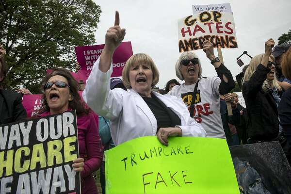 Protesters demonstrate outside the Capitol in Washington as the House voted on a bill repealing and replacing major parts of the Affordable Care Act, on Capitol Hill in Washington, May 4, 2017. The measure, which passed by a count of 217 to 213 with 20 Republicans voting against, faces profound uncertainty in the Senate. (Gabriella Demczuk/The New York Times)