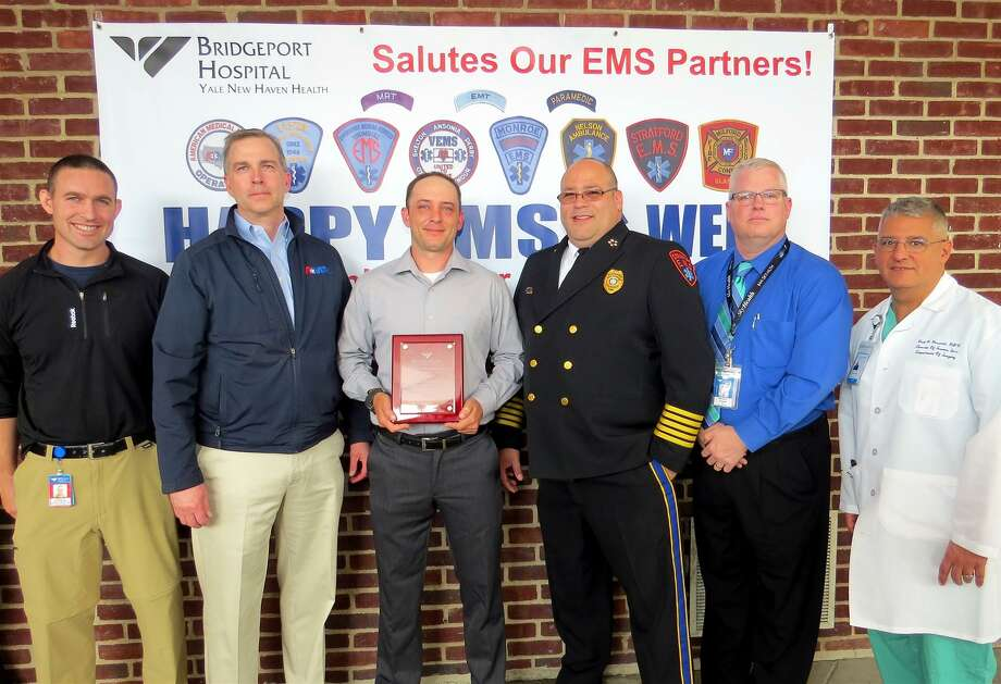 Bridgeport Hospital EMS Medical Director Doug Latham, MD, AMR General Manager Bill Schietinger, Dane Johansson, Stratford EMS Director Michael Roiz, Wesley Young and Hospital Director of Trauma, EMS and Emergency Preparedness Paul Possenti. Photo courtesy of Bridgeport Hospital. Photo: Contributed / Contributed