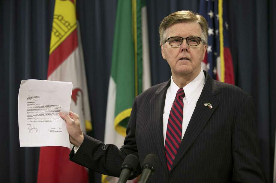 Lt. Governor Dan Patrick holds up a letter supporting real estate tax relief during a news conference at the Capitol in Austin, Texas, on Wednesday, May 17, 2017. Lt. Gov. Patrick issued an ultimatum to the Texas House on Wednesday, saying he must see passage of two of his priorities — property tax relief and limits on transgender-friendly bathroom policies — before the Senate will act on key legislation to keep some state agencies operating. Patrick also said if the House fails to pass either priority, he will press Gov. Greg Abbott to call as many special sessions as necessary to gain approval. (Deborah Cannon/Austin American-Statesman via AP) Photo: Deborah Cannon, MBO / Associated Press / Austin American-Statesman
