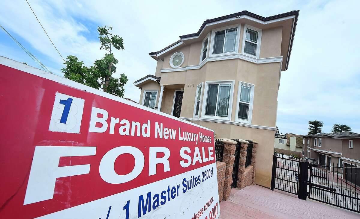 (FILES) This file photo taken on April 25, 2017 shows a for sale sign in Monterey Park, California on April 25, 2017. Sales of existing homes fell in April after posting a 10-year record in March, depressed by the