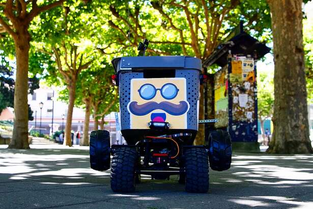 A Kiwibot delivers food around the UC Berkeley campus via Kiwi, a new on-demand delivery service.