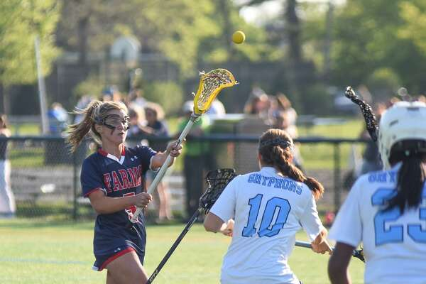 GFA sophomore Ella Murphy passes off to a teammate during her team's FAA semifinal victory over Holy Child. Murphy scored six goals to lead her team to an 11-8 win. She also scored two goals and an assist in the FAA finals against Sacred Heart of Greenwich.