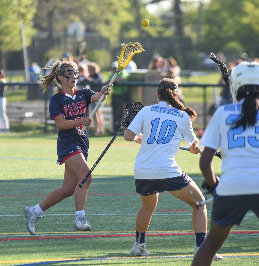 GFA sophomore Ella Murphy passes off to a teammate during her team's FAA semifinal victory over Holy Child. Murphy scored six goals to lead her team to an 11-8 win. She also scored two goals and an assist in the FAA finals against Sacred Heart of Greenwich. Photo: Contributed Photo / Darien News contributed