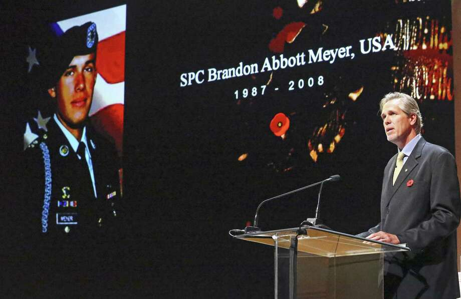 Terry Meyer starts off the program, introducing his son, SPC Brandon Abbott Meyer, as Gold Star Mothers reflect on the deaths of their children during a special Memorial Day ceremony at USAA on May 24, 2017. Photo: Tom Reel, Staff / San Antonio Express-News / 2017 SAN ANTONIO EXPRESS-NEWS