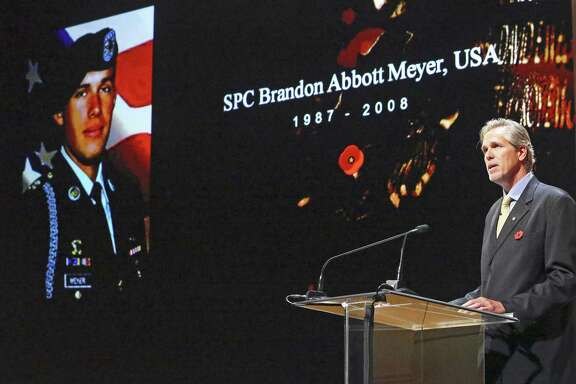 Terry Meyer starts off the program, introducing his son, SPC Brandon Abbott Meyer, as Gold Star Mothers reflect on the deaths of their children during a special Memorial Day ceremony at USAA on May 24, 2017.