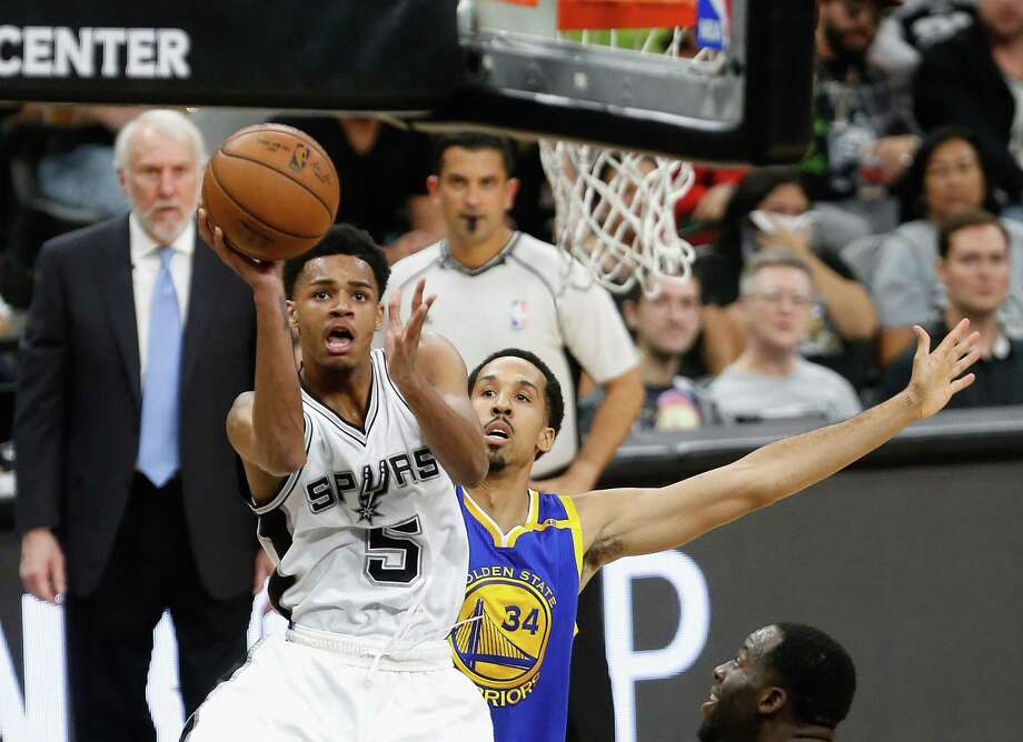 Dejounte Murray of the Spurs shoots against Shaun Livingston of the Golden State Warriors in the first half during Game 4 of the Western Conference finals at AT&T Center on May 22, 2017 in San Antonio. Photo: Ronald Cortes /Getty Images / 2017 Getty Images