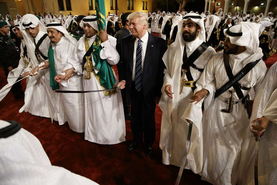 President Donald Trump holds a sword and sways with traditional dancers during a welcome ceremony at Murabba Palace, in Riyadh. Trump and his entourage were treated to a traditional all-male Saudi sword dance. Photo: Evan Vucci, Associated Press