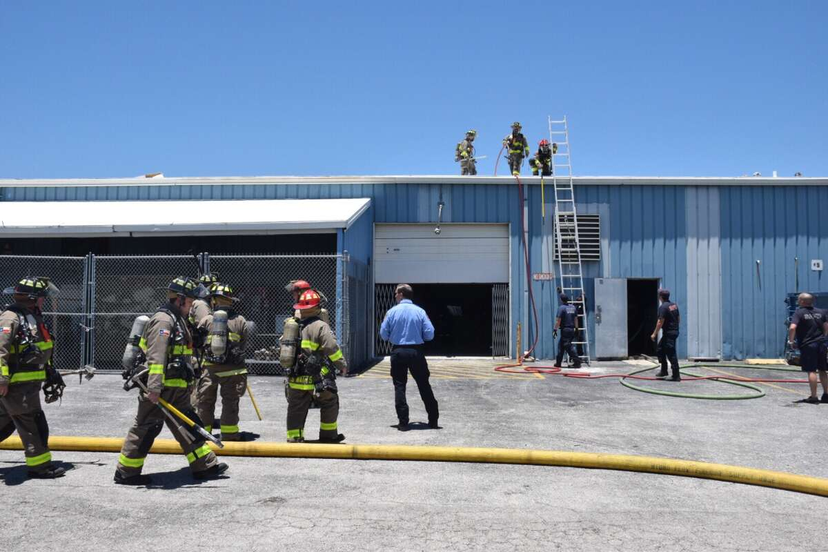 A construction crew working on the roof of an airliner warehouse started a fire Wednesday, May 24, 2017.