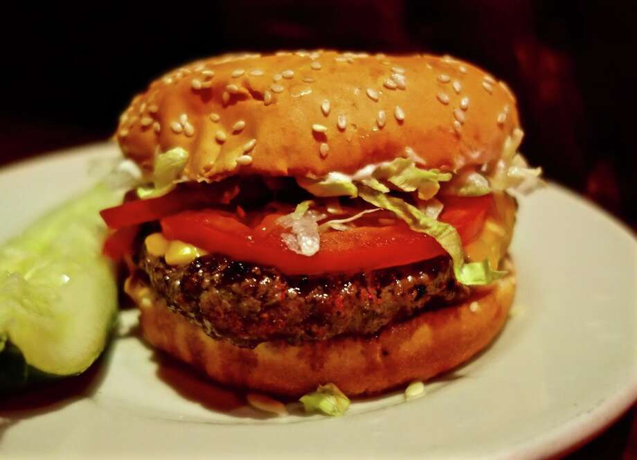 "9. Classic burger with sharp American, Redcoat Tavern, Royal Oak, Mich.""Soft, pliable, lightly griddled bun. Special sauce. Pickles. 
